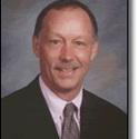 College president F James Cummins :: Baker College of Flint